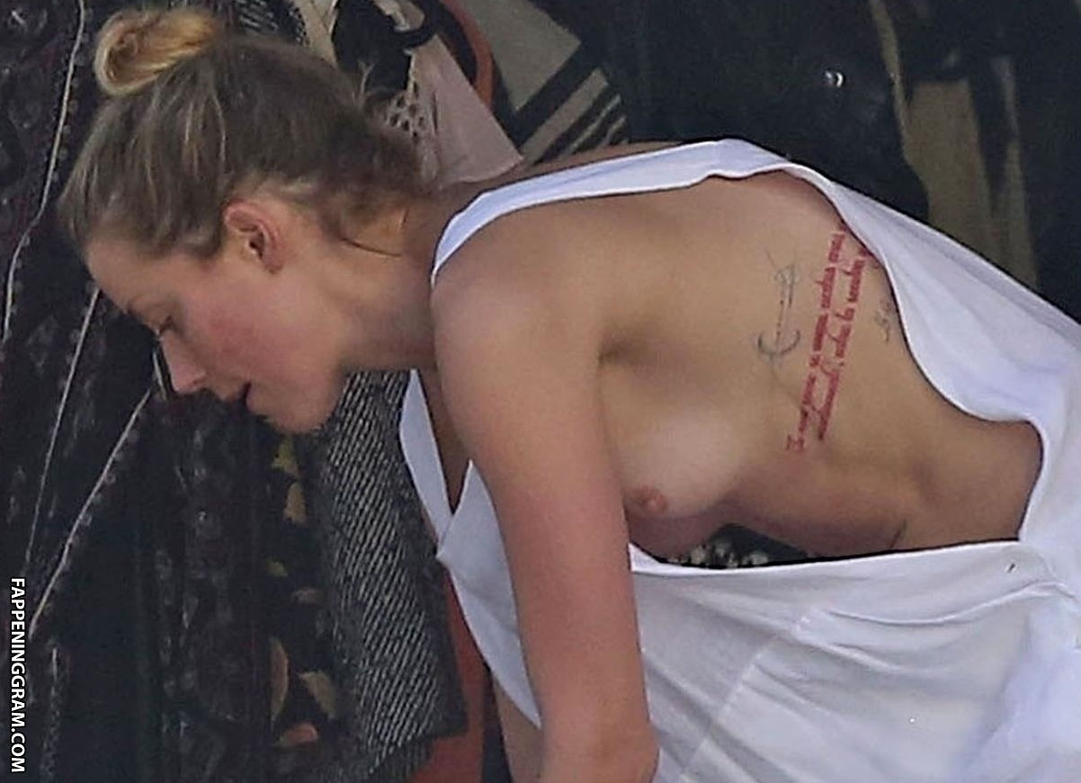 https://cdn.fappeninggram.com/photos/amber-heard/amber-heard-nude266.jpg