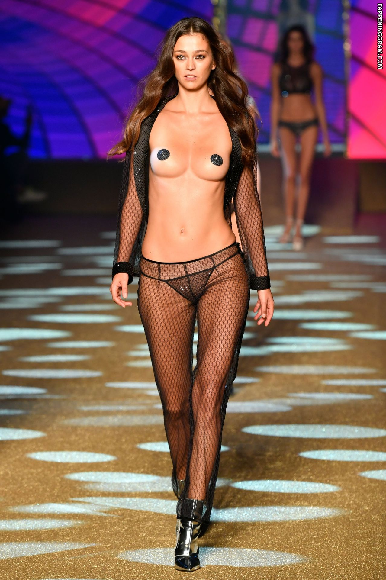 Models with three breasts are sent down the catwalk in a bizarre milan fashion week show